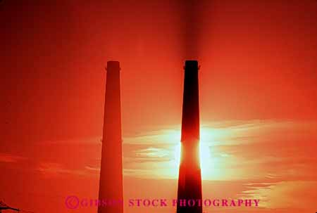 Stock Photo #4981: keywords -  air aviation cylinder cylindrical dawn discharge dusk emission exhaust factory hazard hollow horz industrial industry orange pollution quality round silhouette smoke stacks sunrise sunset tall tube two