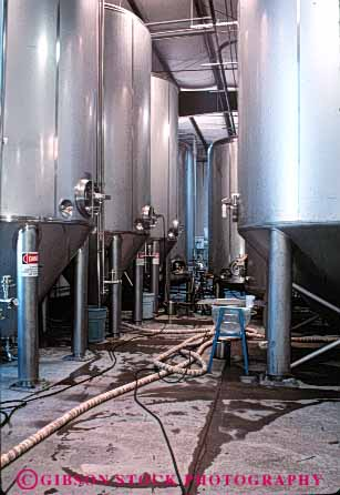 Stock Photo #4997: keywords -  alcohol alcoholic beer beverage brew brewery brewing clean drink drinking equipment metal microbrewry refreshment sanitary serve shiny stainless steel vat vats vert