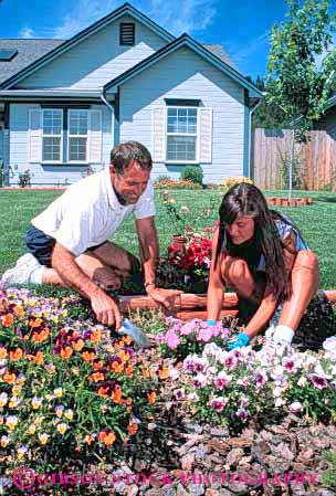 Stock Photo #5061: keywords -  build cooperate couple create cultivate garden gardener gardening grower grown hobby home house outdoor outdoors outside plant plants released residence residential share skill soil summer together vert work