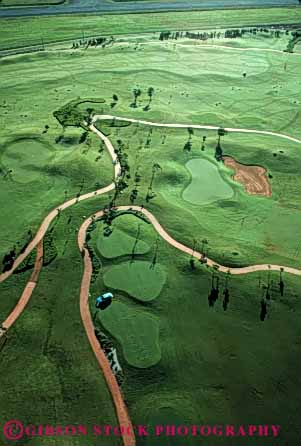 Stock Photo #5076: keywords -  aerial close course cut elevate elevated game golf golfing grass green groom groomed hawaii landscape landscaped lawn lihue manicure manicured route smooth trim trimmed vert westin
