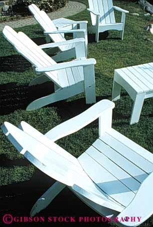 Stock Photo #5086: keywords -  array chairs design exterior furniture grass lawn outdoor outside pattern repeat repetition same seat similar sit summer vert white wood