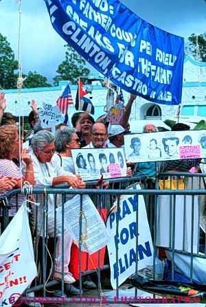 Stock Photo #5140: keywords -  attitude belief believe controversial controversy debatable debate demand demonstrate demonstration elian ethnic expression gonzalez group hispanic house idea issue miami object opinion people political position protect rallies rally share sign social society statement together unified united unity vert