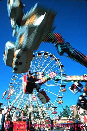 Stock Photo #5173: keywords -  amusement blur calgary fair festival fun motion move movement moving park play rides stampede summer thrill vert