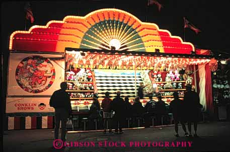 Stock Photo #5180: keywords -  amusement attraction calgary fair festival fun game horz light lighting midway night park play stampede summer