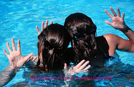 Stock Photo #5222: keywords -  backward backwards cute different face faces fun funny girls hair hairy hand hands head horz humor humorous outdoor peculiar pool released strange summer sunglasses swim swimming water wave wet