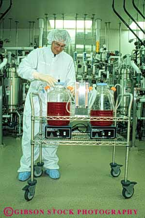 Stock Photo #5242: keywords -  bio-medical bio-medicine biochem biochemical biochemistry bioengineer bioengineering bioengineers biomedical bioscience career chemical chemicals chemistry clean cleanroom equipment exact extract genetech high industry job lab laboratory man manufacture manufacturing medical molecular occupation organic precise precision process released research room sanitary science solution sterile suit tank tech technical technician technicians technology vert vocation work worker working
