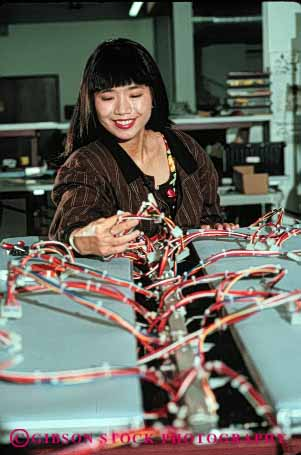 Stock Photo #5250: keywords -  asian assembly career check computer control electric electrical electricity equipment ethnic exact high industry job manufacture manufacturing minority occupation precise precision quality released research science tech technical technician technicians technology test testing vert vocation wire wiring woman work worker worqking