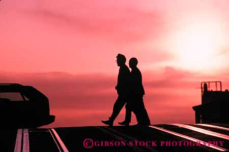 Stock Photo #5333: keywords -  across city cross horz men move pavement pedestrians people road silhouette step street walk walker walking
