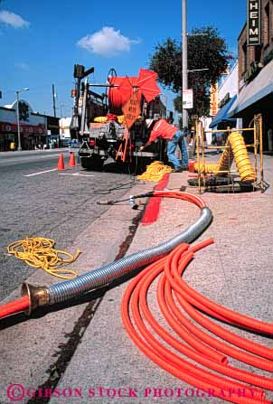 Stock Photo #5450: keywords -  angeles communication communications conduit downtown fiber install job labor laborer los occupation optic optics orange pipe plastic public road street technician technicians technology telecommunications tube under utilities utility vert work worker working