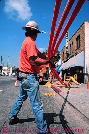 Stock Photo #5451: keywords -  angeles communication communications conduit downtown fiber install job labor laborer los occupation optic optics orange pipe plastic public road street technician technicians technology telecommunications tube under utilities utility vert work worker working