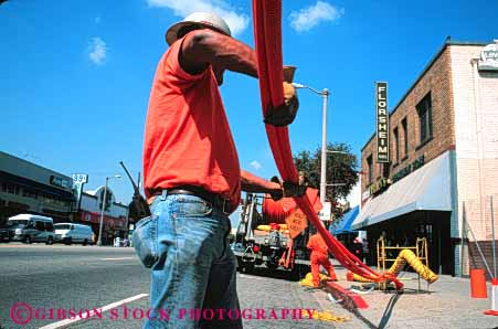 Stock Photo #5452: keywords -  angeles communication communications conduit downtown fiber horz install job labor laborer los occupation optic optics orange pipe plastic public road street technician technicians technology telecommunications tube under utilities utility work worker working