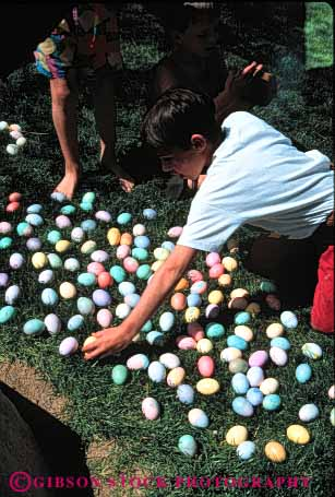 Stock Photo #5463: keywords -  boy boys celebrate celebrating celebration child children christian christianity colored dye dyed easter egg eggs faith holiday kid religion religious round vert youth